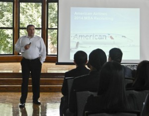 A representative from American Airlines speaks to the graduate student audience.