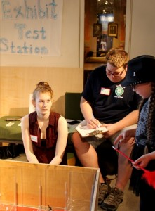 "Amanda Duquenoy '17 and Alex Merriam '17 observe a museum patron at the ""Maps as Models"" exhibit prototype"
