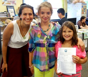 Hazelkorn '15 is pictured with Brittany (age 13) a student at University Park Campus School, and Dakota, (age 8) who attends Goddard Elementary School