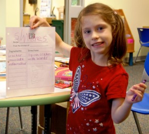 Violet (age 5), a student at Roosevelt Elementary, holds her recipe for s'mores