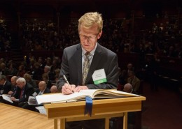 Anthony J. Bebbington, Clark University geography professor and Higgins Professor of Environment and Society, signs the American Academy of Arts and Sciences' Book of Members, a tradition that dates back to 1780.