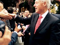 President Bill Clinton shakes hands outside Atwood Hall.