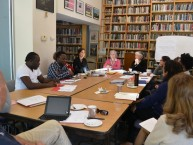 "Participants in the IDCE workshop ""Witnessing: Taking testimonies and constructing refugee narratives"" (Sept. 19-21) gather in the Rose Library at the Strassler Center for Holocaust and Genocide Studies at Clark University. Leading the workshop are Leora Kahn and Anita Häusermann Fábos."